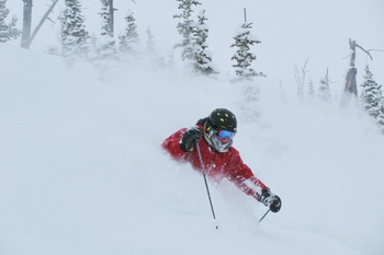 Garth, fellow ski instructor at Castle Mountain, getting lots of powder.